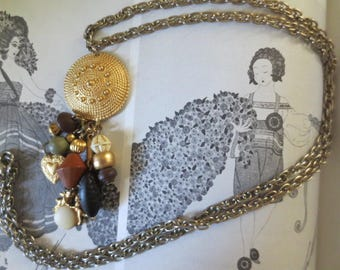 Beaded pendant and chain necklace.