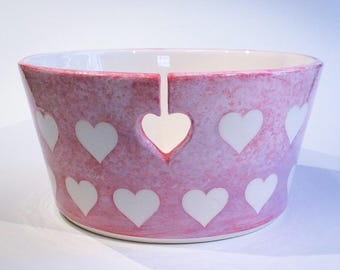 Yarn bowl with white hearts.