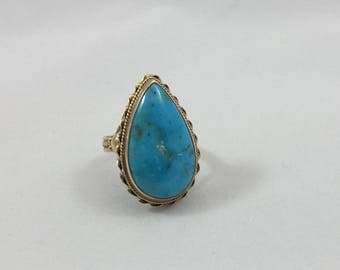 Turquoise, pear shaped, 14 kt yellow gold ring