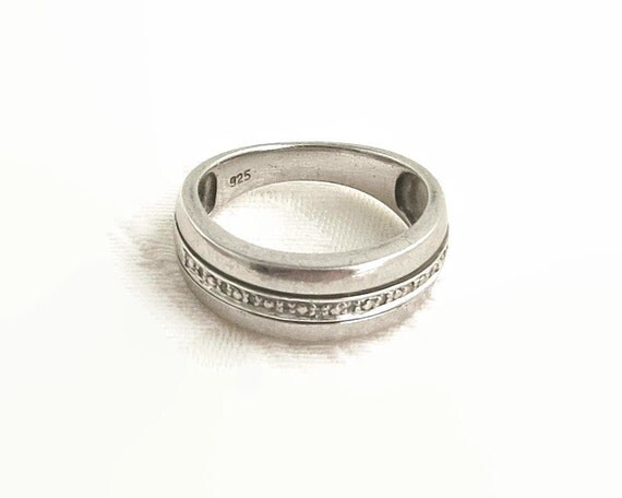 Sterling silver ring with circle of sparkling crystal chips, stamped 925 for sterling silver, size N - UK & 6.75 - US