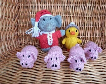 A group of little animals -  elephant, duckling and 4 little piglets with curly tails.  All are ready to ship in one group.