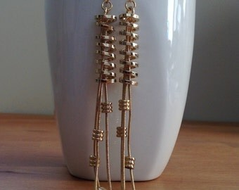 Very long gold coil earrings