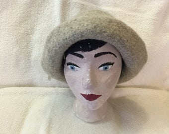 Tan 100% wool felted hat with cord.