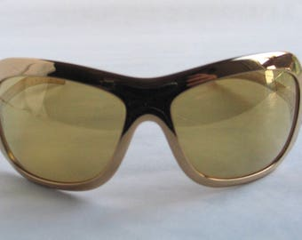 Adidas gold sunglasses made in the 90's in Austria. Rare and collectable!