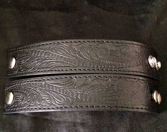 Set Of 2 Soft Worn Black Leather Wrist Cuff With Wmbossed Design
