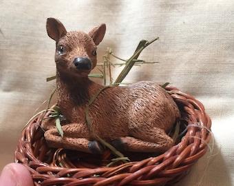 Little deer in basket figurine