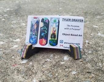 Recycled skateboard business card holder