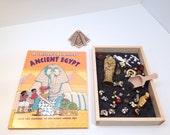 Archaeological dig ancient Egypt sarcophagus loose parts invitation to play Reggio Emilio Waldorf Montessori