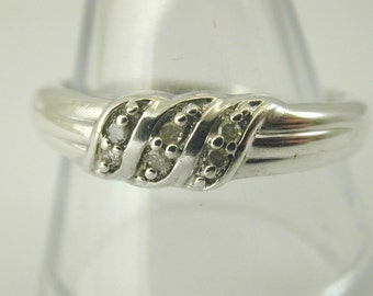 Silver triple twist ring with diamond paste size Q. USA 8. 2.8 grams