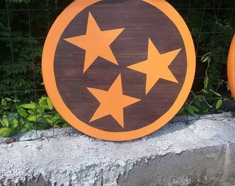 Stained wood round with orange tri-star and border