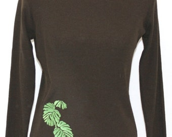 Brown merino wool sweater embroidered with large leaf design.
