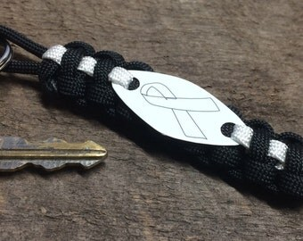White Ribbon Awareness keychain - Blindness, bone disease & bone cancer, Lung Disease and more