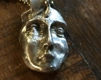 Faces and masks made of fine silver, PMC3.
