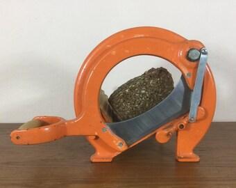 Orange vintage Danish Raadvad bread slicer / cutter. Candle display. Soap cutter. Made in denmark.