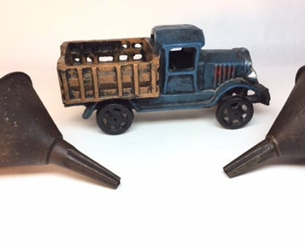 Vintage oil funnels with metal toy truck