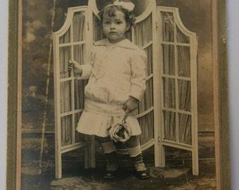Vintage photo.Cardboard framed.Antique folding screen.Little girl.Grey.White.Ephemera.Sepia.Vintage furniture. Vintage mirror.To frame.Gift.