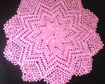 White mottled pink doily
