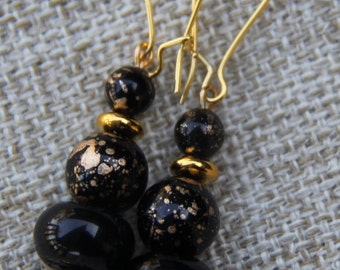 Shell and Czech glass earrings in black and gold