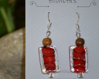 Let's have some candy as these earring's have that look of yumm! with red gold and black swirls in them!