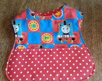 Reversible Baby Bib with Pocket Trains with Red and White Dot