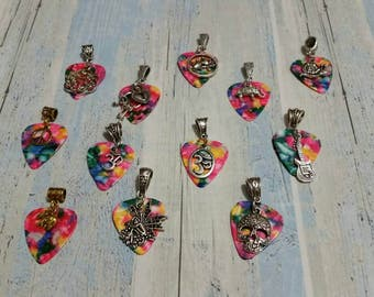 Pink multi-color guitar pick pendants with charms, bail, and chain