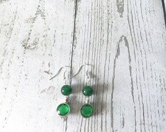 Glitzy silver earrings with forest green and green apple beads.