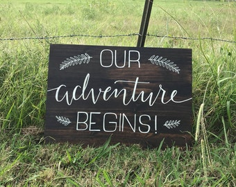 Our Adventure Begins, hand lettered wood sign for weddings and events