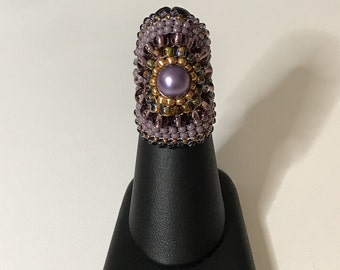 Purple glass pearl focal with gold and purple accents.