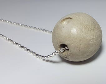 Concrete ball with ball chain