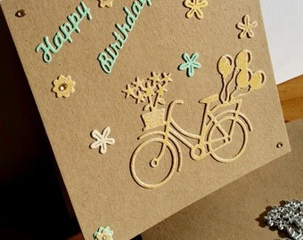 A square Kraft birthday card, handmade, handcrafted, embellished.