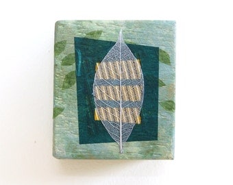 Leaf wall art, mixed media on small reclaimed wood block, abstract in shades of green with silver leaf, zen decor