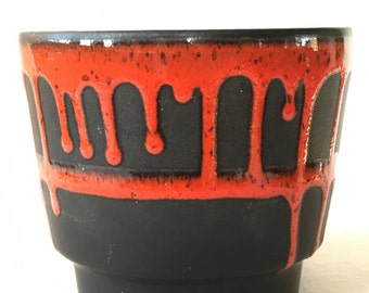 Germany fat lava black with red boempot. Now 20% discount from 24 to 19.20 euros!