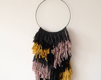 Weaving black and colors to order