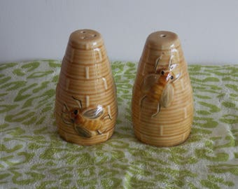 A Salt and Pepper set, made by Secla Portugal. Honey Bee design.