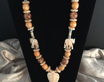Wood and bone Elephant/leaf necklace