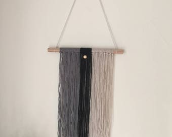 Modern and minimal grey, cream, & black woven wall hanging