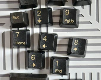 Decorative magnets made from computer keyboard keys
