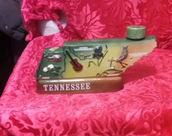 Tennessee vintage liqour bottle in shape of the state. Dated 1969