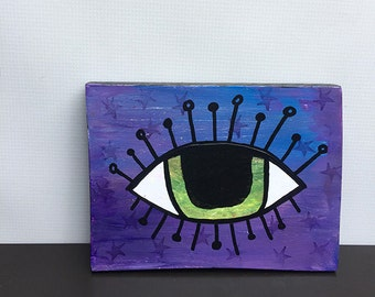 Green Evil Eye On Purple - Eye Art - Original Mixed Media Collage Painting - wall hanging, luck, lucky wall art decor  by Claudine Intner