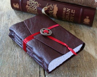 """Leather Journal - Emily Dickinson quote: """"We grow not older with years, but newer every day"""". burgundy . handmade handbound (320 pgs)"""