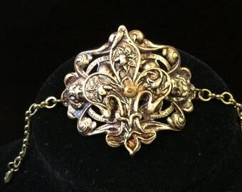 Fleur de Lis cuff bracelet.