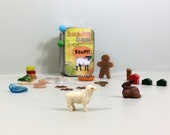 Activity box of tiny toys with sheep, bunny, frog, and random items for quiet play and travel. Child's treasure box. Easter gift for kids.