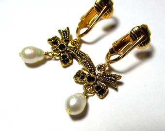 Little white freshwater pearl, drop dangle earrings, gold plated bows, clip on or pierced lever back