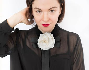 White Ivory flower brooch with a black bow made from ribbon, bow tie brooch with flower