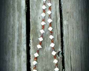 Diamond shaped freshwater pearl and amber necklace with silver clasp
