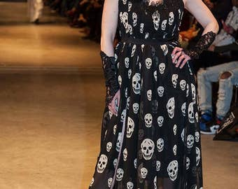 Gothic black skull dress, made with black and white skull chiffon and black lace accents. Adjustable. Size small.