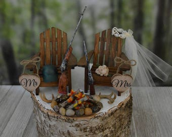 Deer hunter themed wedding cake topper hunting groom bride antlers rack buck doe cake campfire fire pit the hunt is over camouflage Mr Mrs