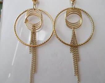 Gold Tone Hoop Earrings with Gold Tone Ring Charms and Gold Tone Chain Dangles