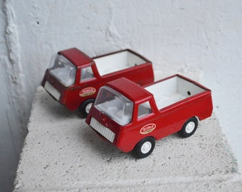 Two Vintage Tonka U.S.A. Rustic Red Trucks