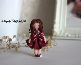 Polymer clay brooch a little girl in a bordeaux dress with bow